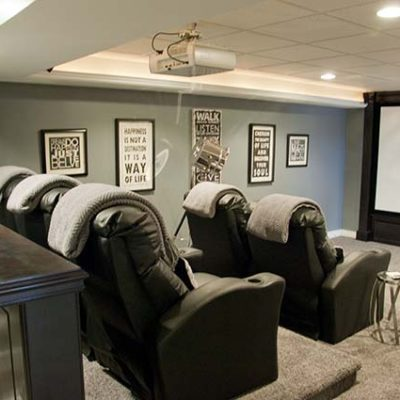The home theater room has a 120 inch screen and accommodates 7 people.